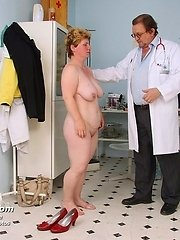 Lousy gynecologist speculum vagina examination senior mamma at hospital